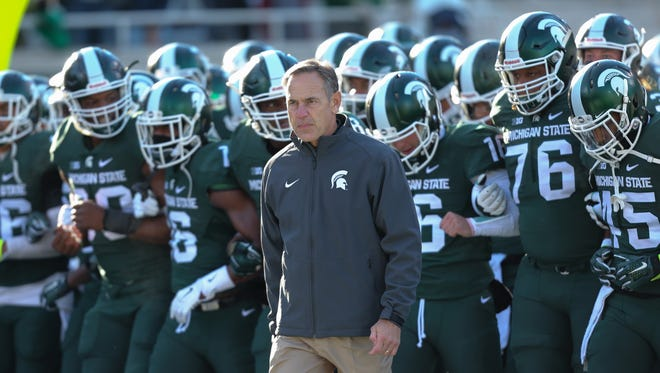 Michigan State Spartans head coach Mark Dantonio leads his team onto the field before their game against the Penn State Nittany Lions on November 28, in East Lansing Michigan.