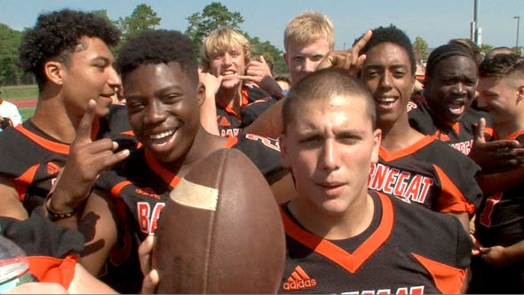 Barnegat High School football players participate in