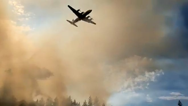 An air tanker flies over the Green Top Mountain Fire near Eagle Point.