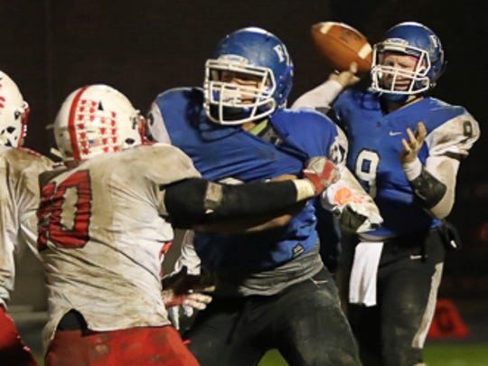 Franklin Central's Payton Ditchley (foreground)