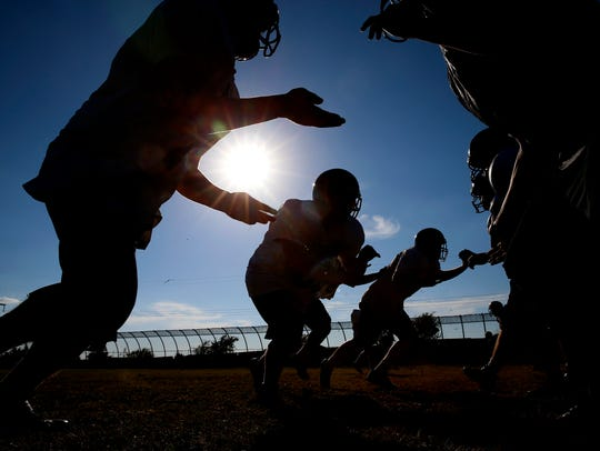 Gainesville State School football players practice