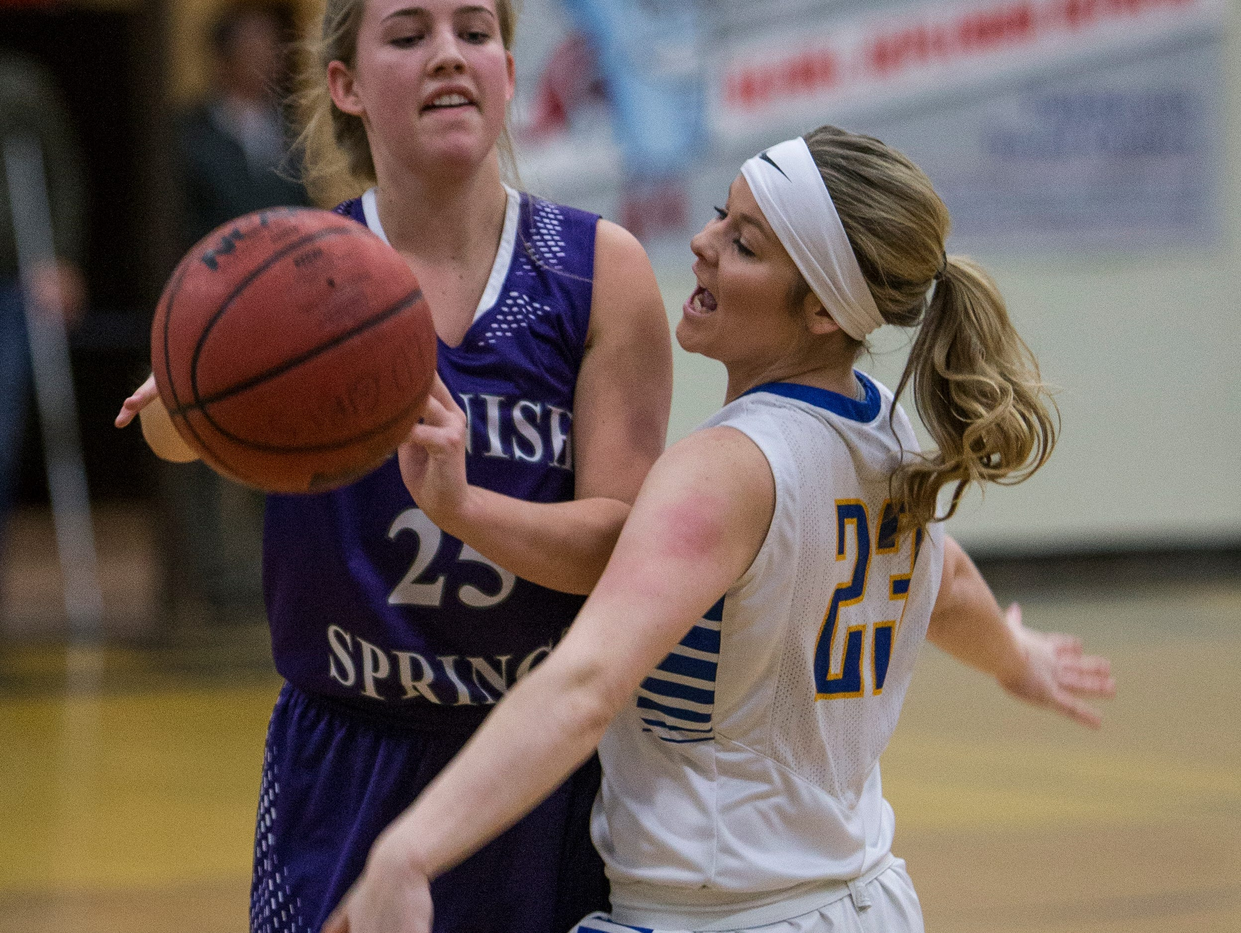 Spanish Springs Cougars Mackenzie O'Connell passes as Reed Raiders Gabby Kahl defends in their basketball game played on Friday night, at Reed.