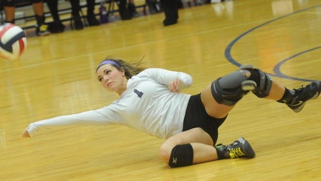 Wylie's Landri Wilson tries to make a diving save against Iowa Park. Wylie won the Class 4A bi-district playoff match 25-14, 20-25, 25-14, 25-13 Tuesday night in Graham.