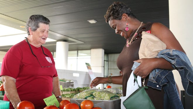 The annual Alfa Farmers Market brought fresh summer produce to Alfa Insurance and Alabama Farmers Federation employees at its Montgomery home office June 27. Seven central and south Alabama farms set up at the market.