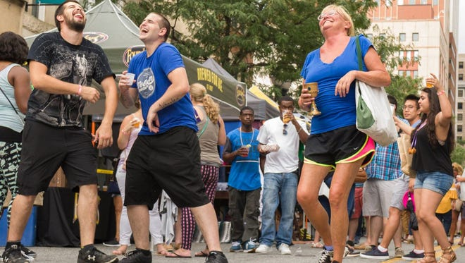Downtown Brewfest attendees have fun at last year's debut event.