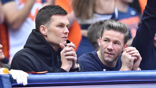 Then Patriots quarterback Tom Brady (left) and wide receiver Julian Edelman attended a North Carolina-Syracuse basketball game at the Carrier Dome on Feb. 29. Brady, who has since signed with the Tampa Bay Buccaneers, is now a member of Seminole Country Club.