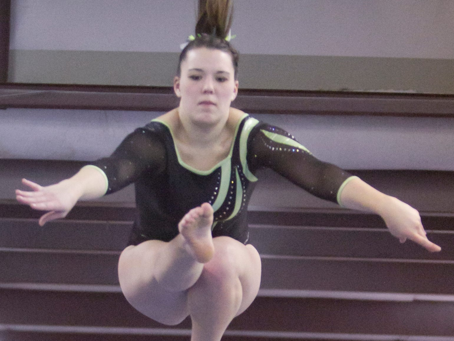 Howell's Marisa DeCamp took second in the all-around in her return from a season-ending neck injury 11 months ago.
