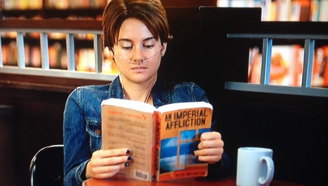 """Shailene Woodley portrays Hazel Grace Lancaster reading """"An Imperial Affliction"""" in """"The Fault in Our Stars."""""""
