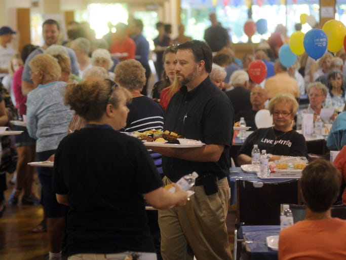 Chris Fisher carries his tray through the line. The 10th annual United Way Fundraiser, Taste of Coshocton, was held Thursday at Lake Park Pavilion.