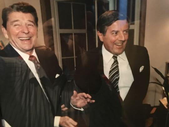 President Ronald Reagan and Richard Lesher, president of the U.S. Chamber of Commerce, share a joke. The photo hangs today in Lesher's house. Reagan was Lesher's favorite president of the five he worked with while leading the Chamber.