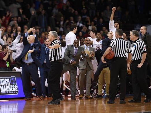 St. Joseph's Hawks bench reacts as game officials rule