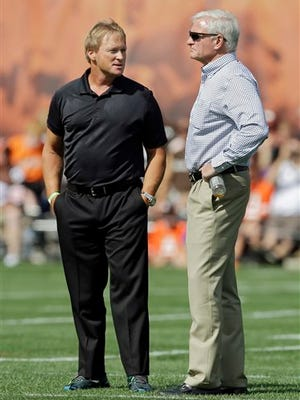 Former NFL head coach and current television analyst Jon Gruden, left, passed on an opportunity to coach at the University of Tennessee.