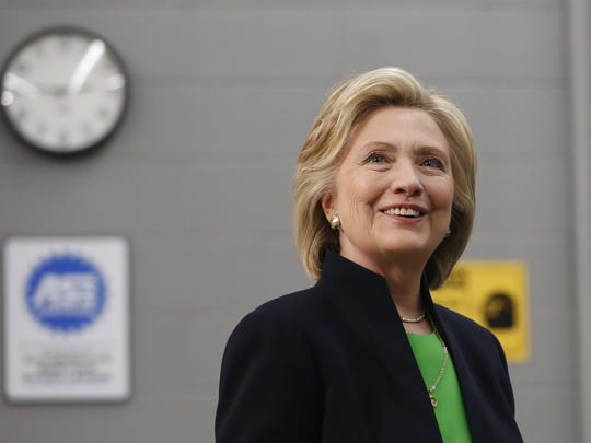 Hillary Clinton Democrat Hillary Clinton smiles at members of the media Tuesday, April 14, 2015, following a roundtable at Kirkwood Community College's satellite campus in Monticello, Iowa.