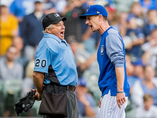 Brewers manager Craig Counsell argues with home plate