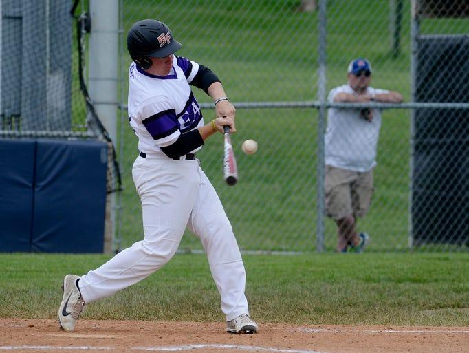 Andrew White bats for Post 15 East as they take on Omaha Burke Sunday at the Milt Simons Invitational at Harmodon Park, June 8, 2014.
