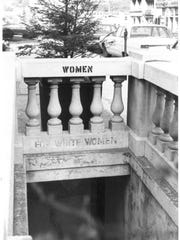 A 1969 photo shows a former segregated bathroom at Pack Square.