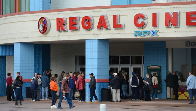 Patrons stand outside Regal Salisbury Stadium 16.