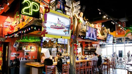 Dick's Last Resort is known for its wild hats and service with an attitude.