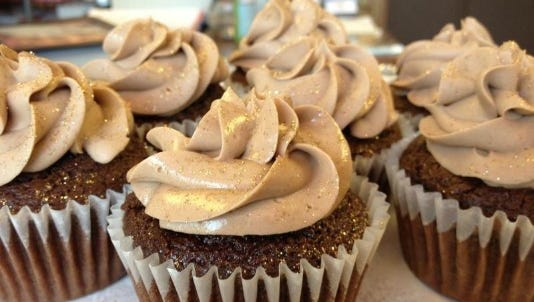 A chocolate-chocolate truffle-filled cupcake from Dulce Desserts.