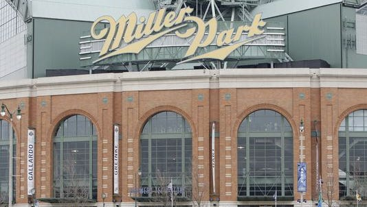 Officials say a fire at the Milwaukee Brewers' ballpark was contained mainly to a restaurant