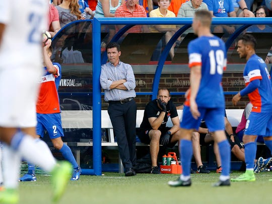 FC Cincinnati head coach Alan Koch watches from the sideline in the first half of the USL Soccer match between FC Cincinnati and Charlotte Independence at Nippert Stadium on June 10, 2017