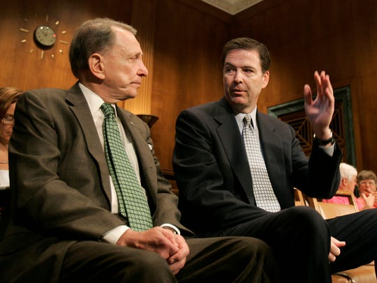 James Comey, right, talks with Sen. Arlen Specter,