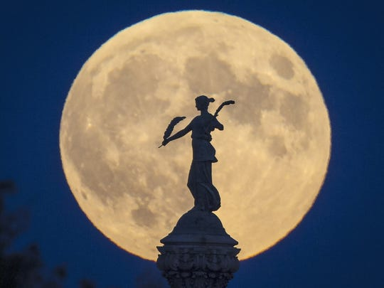 The Civil War Monument at the state Capitol complex is silhouetted against a supermoon  on Sept. 27, 2015, in Des Moines.