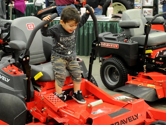 File - Mark Hamilton, 2, tests the lawn mowers at the Arts Alive! Home and Garden Festival Sunday, Feb. 26, 2017, at the MPEC.