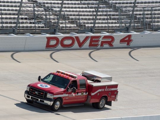 Jeff McCombs, crew chief on the Turn 4 firetruck at Dover International Speedway, drives the rescue truck around the track during preparation day for the upcoming NASCAR race weekend in Dover.