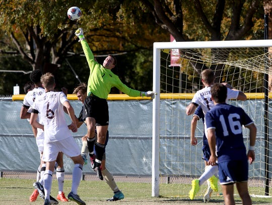 Midwestern State goalkeeper Taylor Lampe hits the ball
