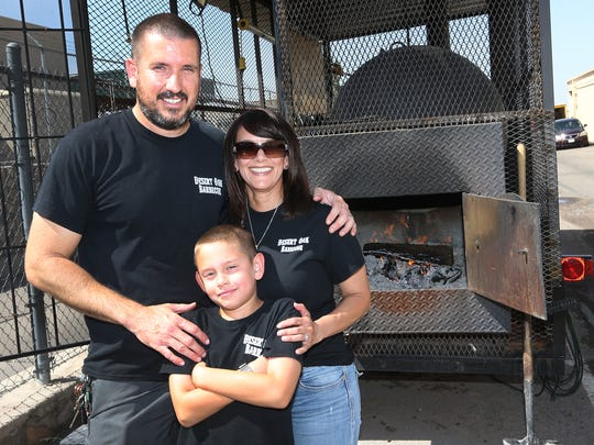 All in the family: Richard Funk with wife, Suzanne and son Marcello, 9 at Desert Oak Barbecue, 1320 N. Zaragoza Road.