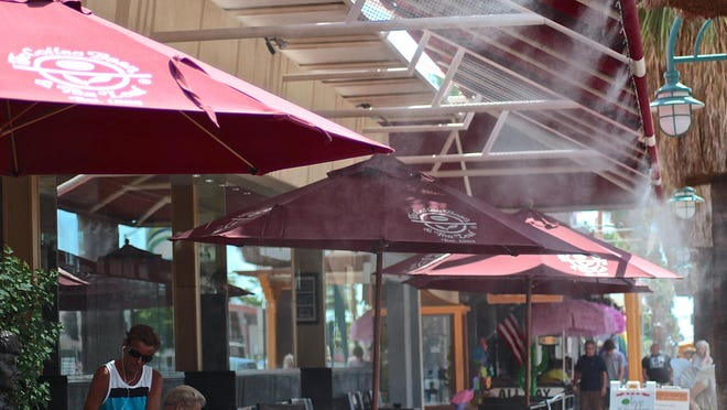 Water misters refresh pedestrians in downtown Palm Springs on July 31, 2015.