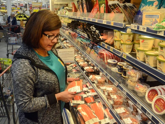 Corpus Christi Slim Down Showdown contestant Jane Alvarez looks at salmon in the seafood area during a pantry makeover at the H-E-B Plus! on Saratoga Boulevard in late January.