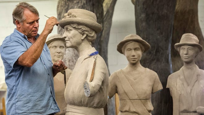 Artist Alan LeQuire works on a monument for women's suffrage at his studio.