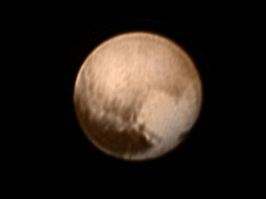 "In the early morning hours of July 8, 2015, mission scientists received this new view of Pluto—the most detailed yet returned by the Long Range Reconnaissance Imager (LORRI) aboard New Horizons. The image was taken on July 7, when the NASA spacecraft was just under 5 million miles (8 million kilometers) from Pluto. This view is centered roughly on the area that will be seen close-up during New Horizons' July 14 closest approach. This side of Pluto is dominated by three broad regions of varying brightness. Most prominent are an elongated dark feature at the equator, informally known as ""the whale,"" and a large heart-shaped bright area measuring some 1,200 miles (2,000 kilometers) across on the right. Above those features is a polar region that is intermediate in brightness."