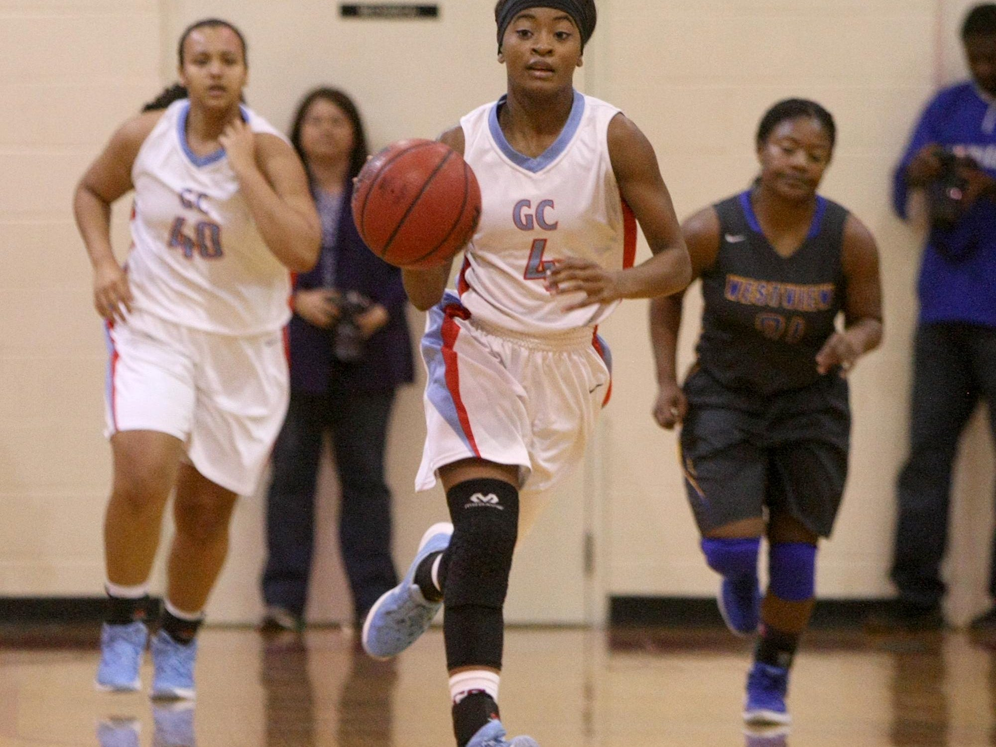 Gibson County's Briana Fields (4) takes the ball down court Saturday against Westview at Bo Booth Gymnasium in Dyer.