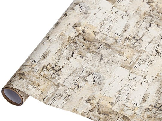 A realistic birch bark pattern graces wrapping paper