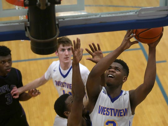 Westview's Justin Johnson (3) goes up for a shot against Ripley's Isaiah Crawley (53) during the Class AA Sectionals at Westview, on Monday.