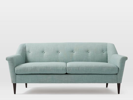 This Finn sofa is offered in nubby wools, velvets, suede and chenille. This more buttoned up approach to upholstery reflects the midcentury vibe, but we're seeing softer materials.