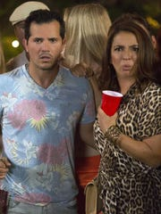 """John Leguizamo and Maya Rudolph are seen in a scene from """"Sisters."""""""