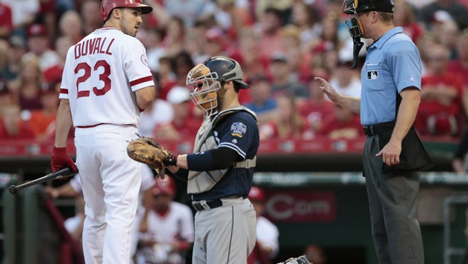 Cincinnati Reds left fielder Adam Duvall (23), left, argues with umpire Toby Basner (99) in the third inning during the MLB game between the San Diego Padres and Cincinnati Reds, Friday, June 24, 2016, at Great American Ball Park in Cincinnati.