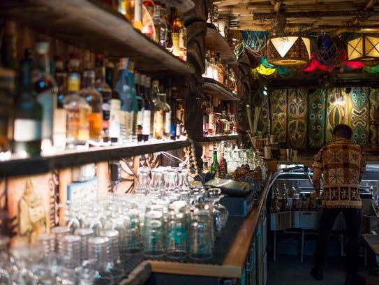 Tony Roehr tends bar at False Idol Tiki Bar in San