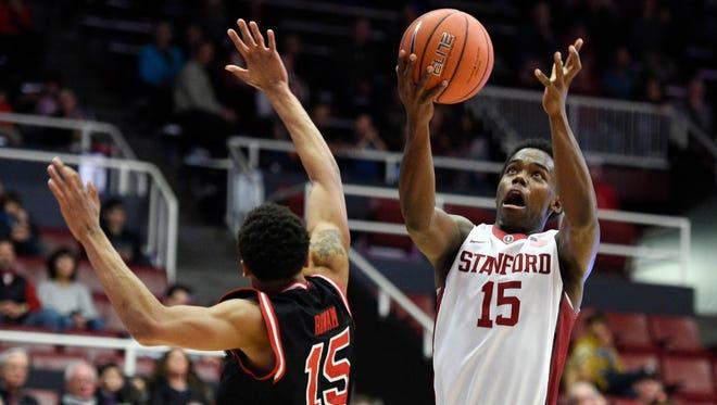 Stanford guard Marcus Allen shoots the basketball against Utah  guard Lorenzo Bonam.