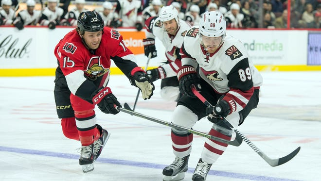 Ottawa Senators center Zack Smith (15) tries to steal the puck away from Arizona Coyotes left wing Mikkel Boedker (89) in the first period at Canadian Tire Centre.