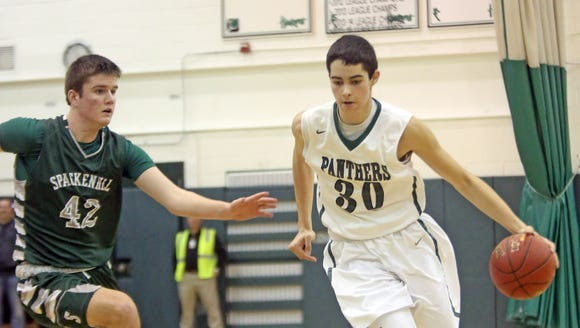 Spackenkill's Tucker Lee (42) guards Pleasantville's