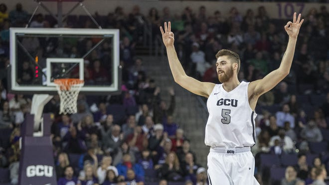 GCU's Matt Jackson (5) celebrates a teammates three pointer against Longwood during the first half at GCU Arena on December 21, 2017 in Phoenix, Ariz.