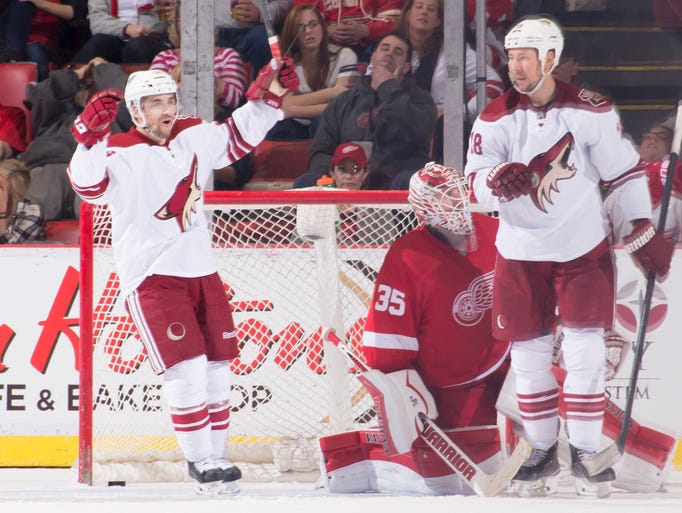 The Coyotes' Mark Arcobello, left, and David Moss celebrate