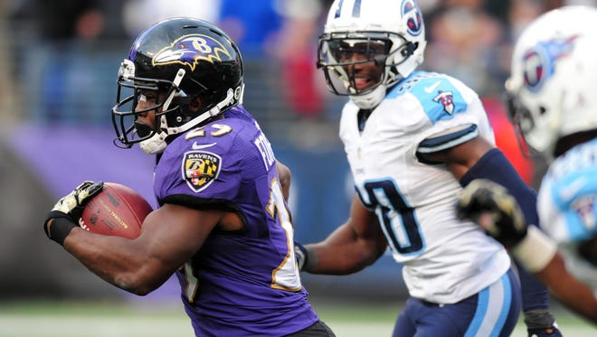Baltimore Ravens running back Justin Forsett  runs with the ball as Tennessee Titans cornerback Jason McCourty chases during their game last week in Baltimore.