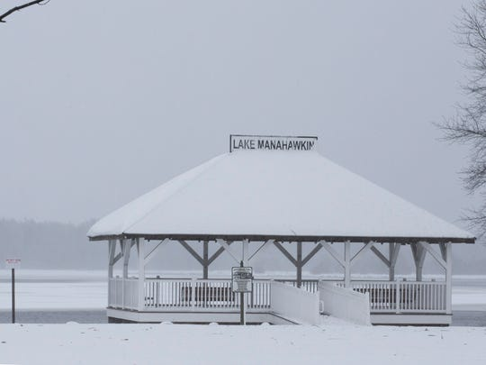 Though the wind blows strongly, the gazebo at Lake Manahawkin sits serenely undistubed by the passing storm.