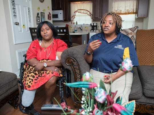 Jamie Scott, left, listens as her sister Gladys Scott tells their life story from home in Pensacola on Monday, July 16, 2018.